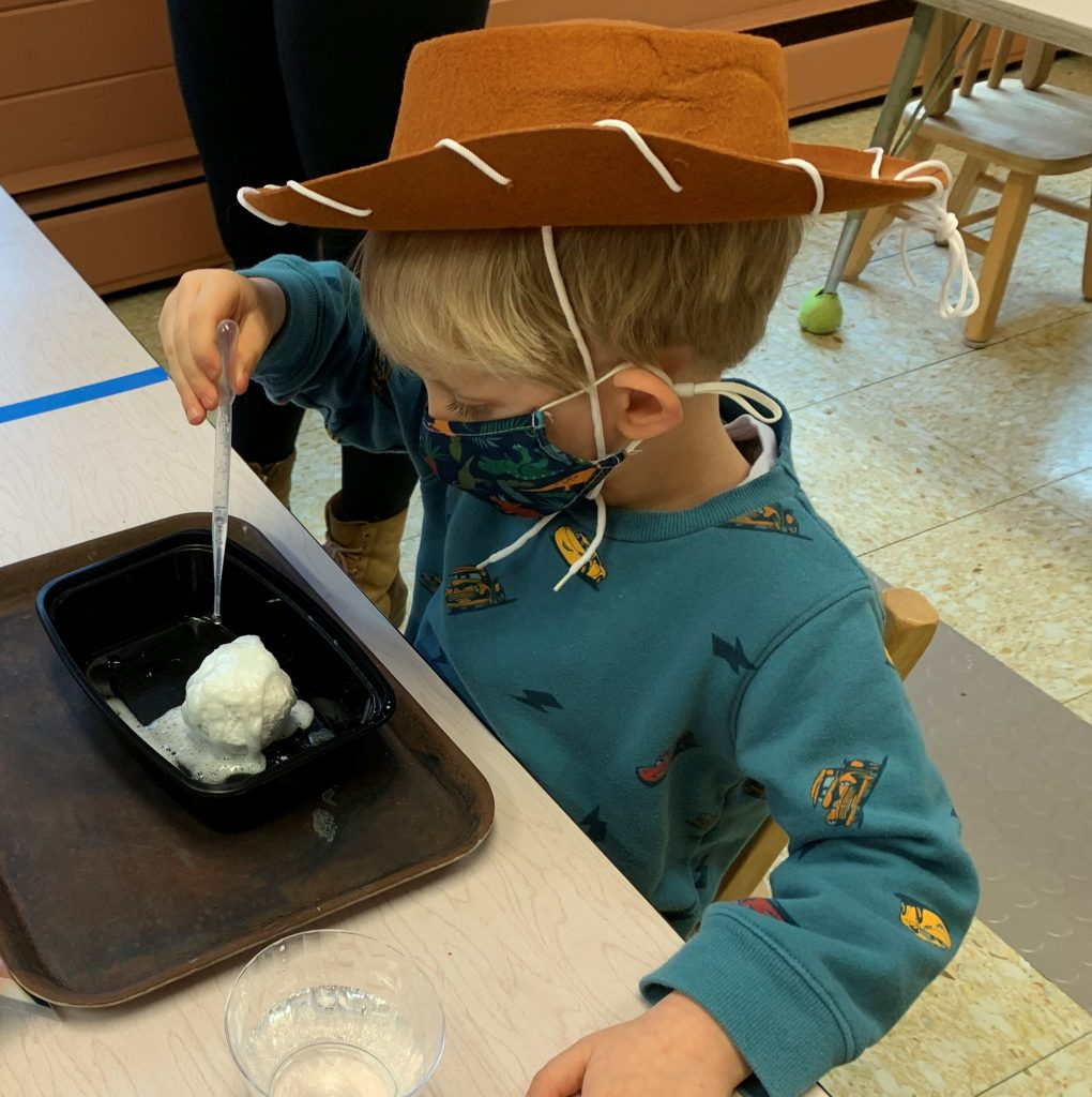 Boy with Hat in class