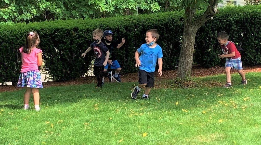 Children running in the garden